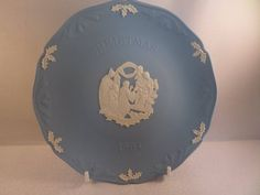 A Christmas plate for 1994 in Wedgwood Jasper ware. This shows Jesus , Joseph and Mary and three wise men. It has a border of bells and bas relief holly leaves and berries. Leaf Border, Three Wise Men, Flower Spray, Christmas Plates, Holly Berries, Holly Leaf, Wedgwood, Pale Pink, Jasper