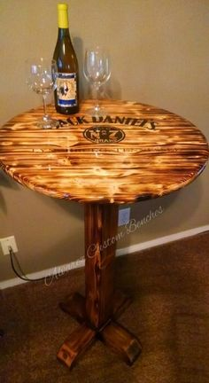 Built this custom table from pine. Burned the wood with torch Jack Daniels, Table Bar, Diy Table, Pub Tables, Repurposed Furniture, Pallet Furniture, Diy Wood Projects, Wood Crafts, Woodworking Plans