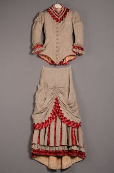Day dress, two pieces, 1882. Light brown wool trimmed with red striped satin. Centraal Museum via Europeana Fashion