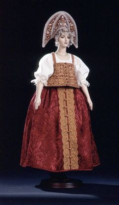 "Alexandra Kokinova ""Lyubava"" LE 250. Lyubava wears an ethnographically exact and traditional costume of a young married peasant woman from Nizhniy Novgorod Province (late 18th - early 19th century). Costume has meticulously hand-embroidered silk and hand-knitted laces. I especially love the kokoshnik :)"