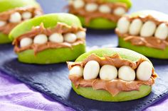 What you're eating on Halloween doesn't need to be scary. We rounded up healthy Halloween snacks that beat out candy bars any day. Scary Halloween Food, Halloween Treats For Kids, Halloween Party Snacks, Halloween Fruit, Halloween Birthday, Happy Halloween, Halloween Teeth, Halloween Meals, Halloween Buffet
