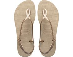 <p>The Luna Sandal features a metallic braided slingback strap with atonal Havaianas logo for a stylish look and extra secure fit. Comfortcomes courtesy of our signature textured footbed.</p><ul><li>Thong style with slingback strap</li><li>Cushioned footbed with textured rice pattern and rubber flip flopsole</li><li>Made in Brazil</li></ul>