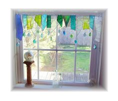 oh wow!....just.....wow  Serendipity glass window treatments on etsy  Little LaLa Originals