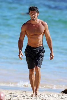 2013 'The Bachelor' Australia Tim Robards displays an impressive physique on Bondi Beach.