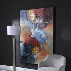 Hand painted on canvas, our Summer Sunset Abstract Art showcases rich red and deep blue tones with silver and gold leaf highlights and a matte black gallery frame. Due to the handcrafted nature of this artwork, each piece may have subtle differences. This piece may be hung horizontal or vertical. Designed by Carolyn Kinder International for Uttermost Company.