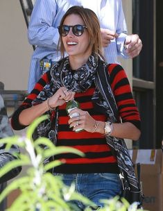 Alessandra Ambrosio Photos Photos - Model Alessandra Ambrosio stops by the Brentwood Country Mart to get a juice in Brentwood, California on January 14, 2015. Alessandra laughed and chatted with some friends as she made her way to the car. - Alessandra Ambrosio Goes Shopping