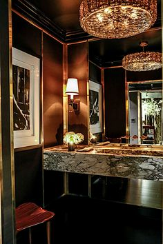 Lichten Craig 2017 Kips Bay powder room: With elegant details and fixtures, photographs from Staley-Wise of glamorous people having fun in dark spaces added to the sexy allure.