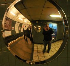 Me in the mirror at Vauxhall Tube Station. April 2012.