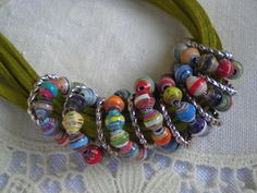 love the combo of metal/leather with paper beads.