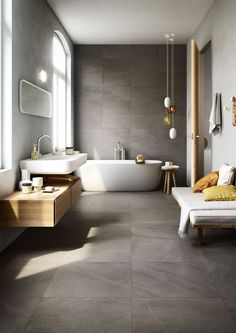 Love the dark grey tile running from floor up one wall with lighter walls either side. Also like wood. Would have put internal shelf with lighting along length of grey wall by bath