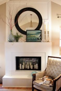 I like the idea of a faux fireplace that has a mirror & candles inside it instead of an actual or electric fire.  I'd use this idea in a bedroom.