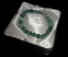 Bracelet made of semiprecious stones Agate green with a sign of the zodiac