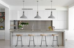 white, concrete and stainless steel kitchen