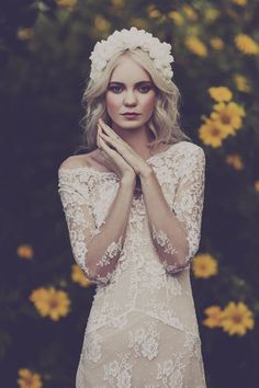 Such a beautiful lace wedding dress and the flower crown adds more to it!