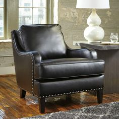 This faux leather chair is finished with chic nailhead accents. Urbanology Accent Chair | Weekends Only Furniture and Mattress