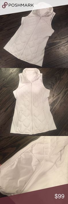 "Lululemon White Down for a Run Vest 4 This is the cozy Down for a Run Vest from Lululemon. It no longer has the Rip tag, but size dot in pocket confirmed 4. The sides are stretchy rule and front & back quilted down. 2 zippered pockets on front one of which also has tech sleeve for keeping phone stable. 2 interior open side pockets as well. Very good condition with very minor piling. my daughter got as a present and only wore a few times. Light but warm & easy to pack. 15.5"" unstretched at…"