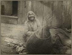 Photograph of an Indian woman sitting weaving a burden basket. ca. 1900. A. W. Ericson, Photographer.