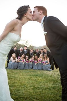 Love this shot! Great wedding photo idea with bridal party in the back.