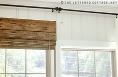 Clever solution to allowing as much light in as possible. The shades are mounted outside the window frame, but higher up to allow as much light in as possible.