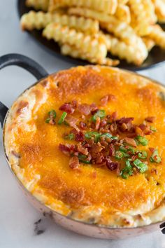 This warm loaded baked potato dip is served hot and full of delicious flavor. Packed full of cream cheese, sour cream, green onions, bacon and of course CHEESE! Perfect when served with french fries or potato chips! Baked Potato Dip, Loaded Baked Potato Casserole, Loaded Baked Potatoes, Dip Recipes, Cooking Recipes, Frosting Recipes, Easy Recipes, Appetizer Dips