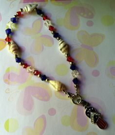 Nations Pride Anklet   Made with natural shells, red, white & blue brilliance crystals, silver tone accent & flag flip flip charm. Without charm $6.00 With charm $7.00