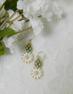 These pretty Swarovski Daisy earrings have a Swarovski pearl in the center - very summer-like! I used Pastel white & green SuperDuo beads, galvanized gold 11/0 seed beads, & Genuine Swarovski 4mm Gold Pearls for the center. They hang on 14K/20 Gold Filled earwires. They are about 1 1/2