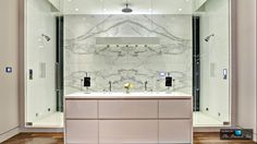 A steam shower fit for the gods — it's quite fitting that it takes center stage in this bathroom space. You rarely see a set up like this, but the beautiful marble and incredible finishes calls for a design just as unique around it.