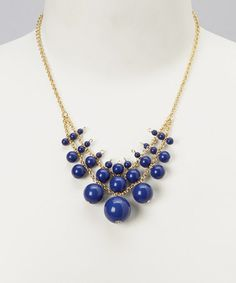 Great Navy Bead Bib Necklace by ZAD on #zulily http://www.zulily.com/invite/blondemomblog (my affiliate link)