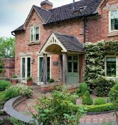 Do you prefer the traditional look or the modern look? and garden uk magazine country living Cottage Porch, Cottage Exterior, Interior Exterior, Cottage Homes, Cottage Style, Brick Cottage, Garden Cottage, Interior Design, Beautiful Houses Interior