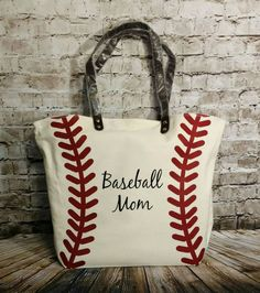 This baseball bag is big and perfect to carry everything youll need to the game!! The tote has a snap closure and 1 inside zipper pocket. The material of the bag is canvas.  Size is 20x17x6  Vinyl personalization is applied with an industrial grade heat press.  Please include the follow items in your order:  1. Color of vinyl or glitter vinyl 2. Monogram (first, last, middle) or name 3. Monogram style  Please note that I will make the monogram on the bag in the order you send it.  If you do…
