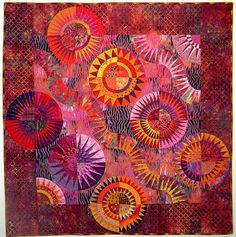 "Quilt Inspiration:Norma Schlager is an award-winning fiber artist whose quilts are often distinguished by their use of saturated hues and vivid contrast, as in ""Heat Wave"", above. This magnificent quilt, with its undulating waves and New York Beauty stars, was a first Place winner and Judge's Choice Award at the Vermont Quilt Festival. We love the diagonal setting, which adds a dynamic quality to the design."