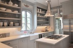 Suzie: Sally Wheat Interiors - Chic gray kitchen design with gray kitchen cabinets painted ...