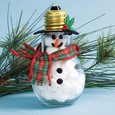 Fill a spent lightbulb with tiny cotton balls (or even miniature marshmallows!) to create a cute snowman ornament // link now dead; looking for replacement