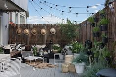 string lights draped over the patio for a magical mood- image via Annettechristian.com