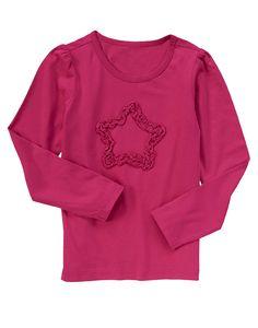 Star style! Ruffles add fun fashion to soft cotton. $6.99