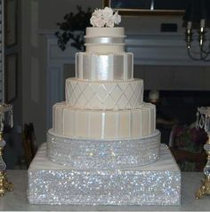 silver and white wedding cake, so elegant!