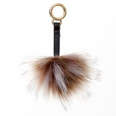 Brown, white and gray fur pom pom and charm for handbags from Surell Accessories.