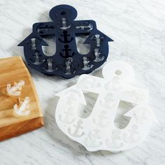 "Ice Cube Tray - Anchor | west elm -- $10.99 on sale -- Make mini ice sculptures. Our Silicone Ice Tray turns water into frozen anchors. The soft, pliable container makes it easy to pop them out. -- 8.7""w x 8.3""d x 1.2""h. -- Silicone gel. -- 12 cubes per anchor. -- Imported. -- Saved 3-3-17"