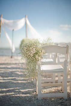 Baby's Breath for destination beach wedding & bamboo & chiffon arch Sanibel Island Wedding by Wed Perfect + Casa Ybel Resort  Read more - http://www.stylemepretty.com/2011/08/15/sanibel-island-wedding-by-wed-perfect-casa-ybel-resort/