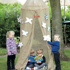 Outdoor Weaving Canopy.  A cosy place for shade and shelter as well as a decorative resource to weave into marvellous creations. Hang the den canopy from branches, ceilings, brackets etc.   Because the cover is made from a natural material (Jute Scrim) the strands can be easily parted, enabling the children to weave ribbon, leaves, tinsel, thread etc. It is great for tying messages, hopes, ideas etc. Imagine leaving questions for the fairies or covering the canopy with stars or leaf shaped…