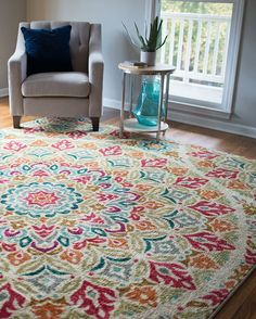 Full of brilliant color and life, the Jerada area rug will invigorate your space with a striking wash of jewel tones layered over a versatile neutral base.