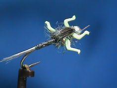 Hook: 2xl Nymph #12 - #18 Bead: 3mm Silver Thread: Black Tail: Dark Blue Dun Hackle Abdomen: Stripped Peacock Herl WingCase: Turkey Wing/Tail Legs: LivelyLeg...