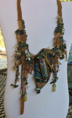 Out of this world free form necklace in gold and teal. by JudesArt, $235.00. SOLD