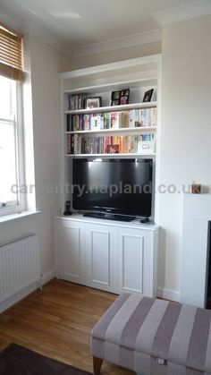 Traditional alcove bookcase and cupboard in Balham SW12