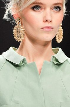 Not sure what I like more, the mint coat or the chandelier earrings...