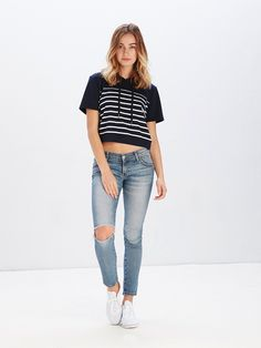 2212ef91e55bf1 Features a relaxed crop silhouette with drawstrings at neckline and striped  design at both front and back. Reckless Girls LA