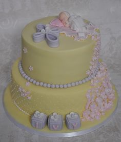Christening cake in pale lemon, pale lilac and pale pink