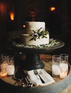rustic wedding cake decorated with olive branches and lavender