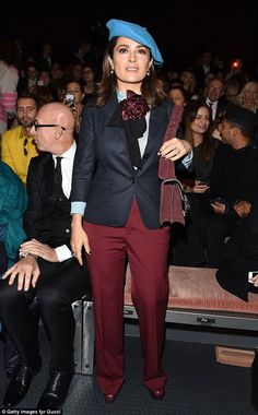 New look: Salma Hayek's androgynous look was a far cry from her normal, feminine style as she attended the Gucci Autumn/Winter 2015/16 show during Milan Fashion Week on Wednesday