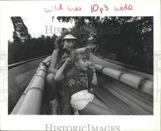 This is an original press photo. Angie Panzica, 9, and Peter Sayegh, 10 react predictably to the cold, wet stuff while going down the bamboo chute ride at AstroWorld with camp counselor Helen Montesion.   eBay!